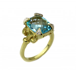 14kt Flourish ring with Blue Topaz and .10pts diamonds